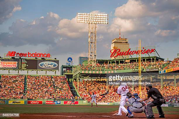 David Ortiz of the Boston Red Sox hits a tworun home run against the Texas Rangers in the first inning on July 6 2016 at Fenway Park in Boston...