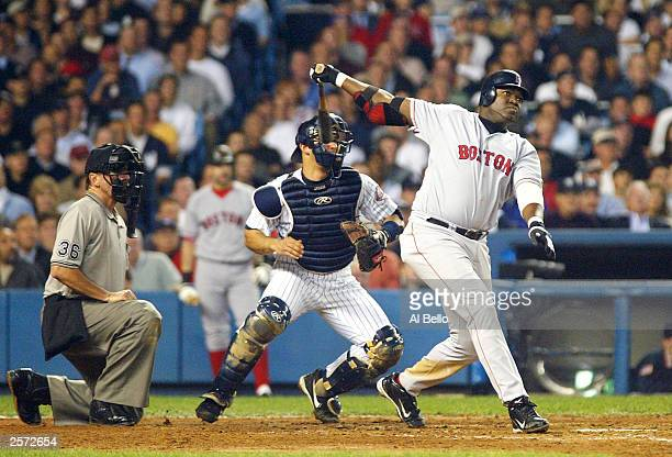 David Ortiz of the Boston Red Sox hits a tworun home run in the top of the forth inning against the New York Yankees during game 1 of the American...