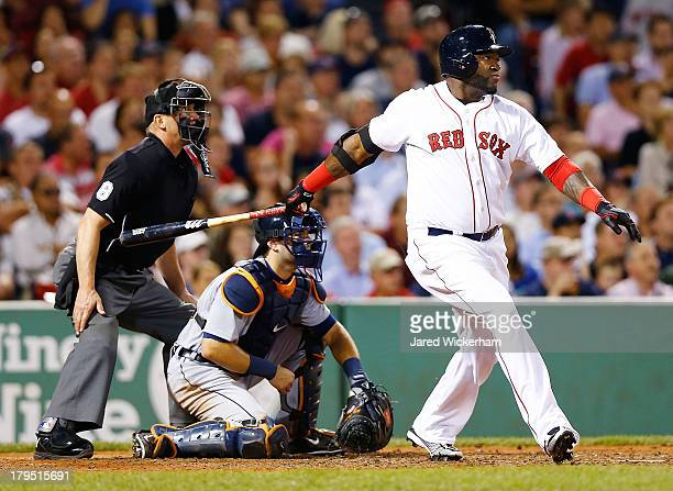 David Ortiz of the Boston Red Sox hits an RBI double in the 6th inning against the Boston Red Sox for his 2000th career hit during the game on...