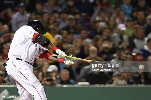 David Ortiz of the Boston Red Sox hits an RBI double in the fourth inning during the game against the Colorado Rockies at Fenway Park on May 24 2016...