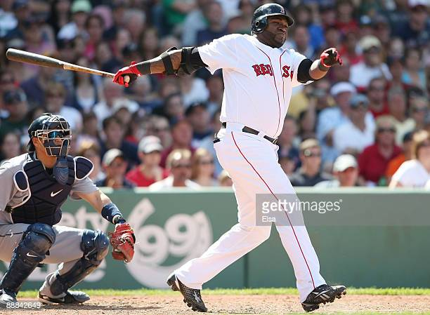 David Ortiz of the Boston Red Sox hits an RBI single in the seventh inning as Kenji Johjima of the Seattle Mariners defends on July 5 2009 at Fenway...