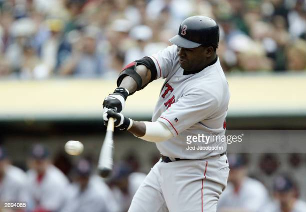 David Ortiz of the Boston Red Sox hits the ball against the Oakland A's during Game 2 of the 2003 American League Division Series on October 2 2003...
