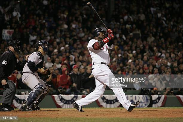 David Ortiz of the Boston Red Sox hits the game ending two run home run in the twelfth during game four of the ALCS against the New York Yankees at...