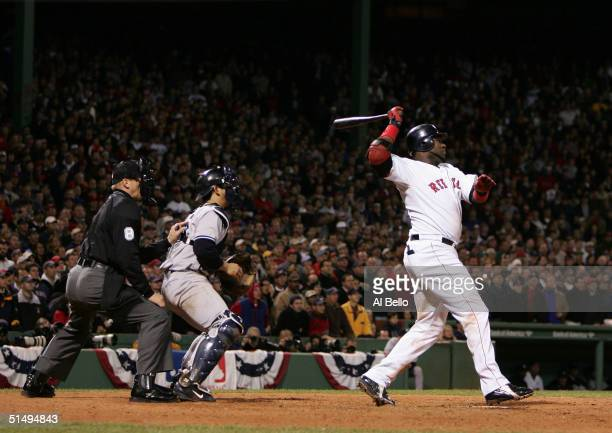 David Ortiz of the Boston Red Sox hits the game winning RBI single in the fourteenth inning to defeat the New York Yankees 54 during game five of the...