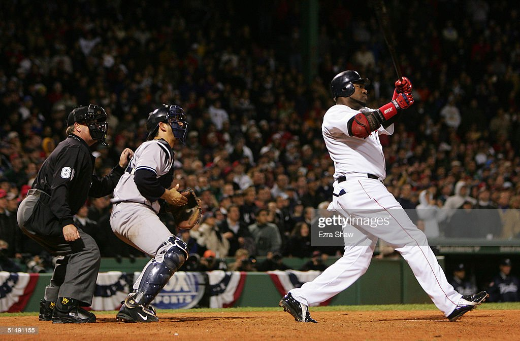 David Ortiz #34 of the Boston Red Sox hits the game winning two-run home run against the New York Yankees in the twelth inning during game four of the American League Championship Series on October 17, 2004 at Fenway Park in Boston, Massachusetts.