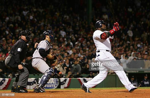 David Ortiz of the Boston Red Sox hits the game winning tworun home run against the New York Yankees in the twelth inning during game four of the...