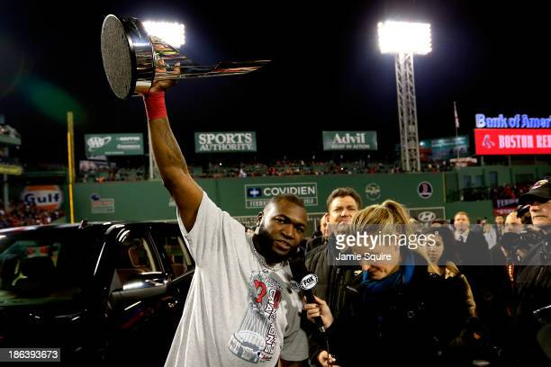 David Ortiz of the Boston Red Sox holds up the MVP trophy following a 6-1 victory over the St. Louis Cardinals in Game Six of the 2013 World Series...