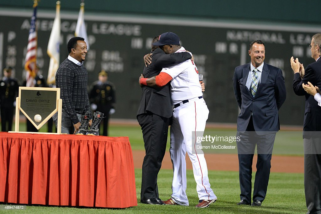 David Ortiz #34 of the Boston Red Sox hugs Jason Vartitek as Pedro Martinez (L) and Tim Wakefield look on during a ceremony to honor his 500th home run hit last week in an away game at Fenway Park on September 21, 2015 in Boston, Massachusetts.