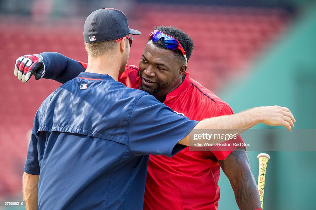 David Ortiz #34 of the Boston Red Sox hugs Joe Mauer #7 of the Minnesota Twins before a game on July 23, 2016 at Fenway Park in Boston, Massachusetts.