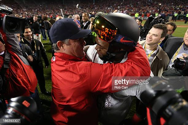 David Ortiz of the Boston Red Sox hugs manager John Farrell after defeating the St. Louis Cardinals 6-1 in Game Six of the 2013 World Series at...