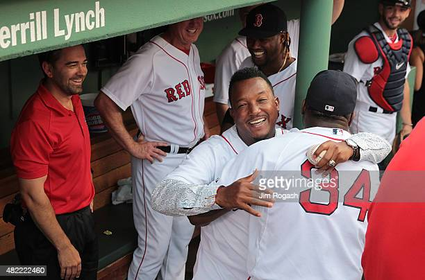 David Ortiz of the Boston Red Sox hugs Pedro Martinez a former member of the Boston Red Sox after a ceremony to retire Martinez's number 45 before a...