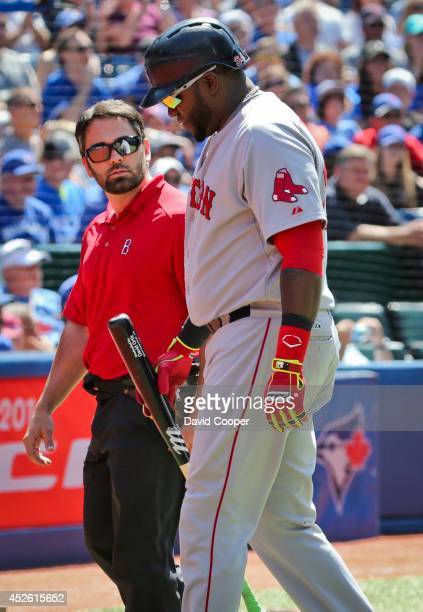 David Ortiz of the Boston Red Sox injures himself at the plate in the top of the 9th and had to leave the game with help of Brad Pearson, Assistant...