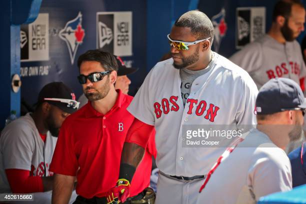 TORONTO ON JULY 24 David Ortiz of the Boston Red Sox injures himself at the plate in the top of the 9th and had to leave the game with help of Brad...