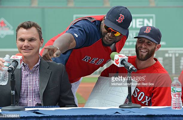 David Ortiz of the Boston Red Sox interrupts a press conference announcing the signing of an eight year contract for Dustin Pedroia by General...