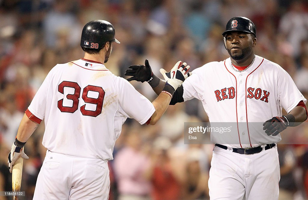 David Ortiz #34 of the Boston Red Sox is congratulated by Jarrod Saltalamacchia #39 after Ortiz hit a solo home run in the seventh inning against the Baltimore Orioles on July 7, 2011 at Fenway Park in Boston, Massachusetts.