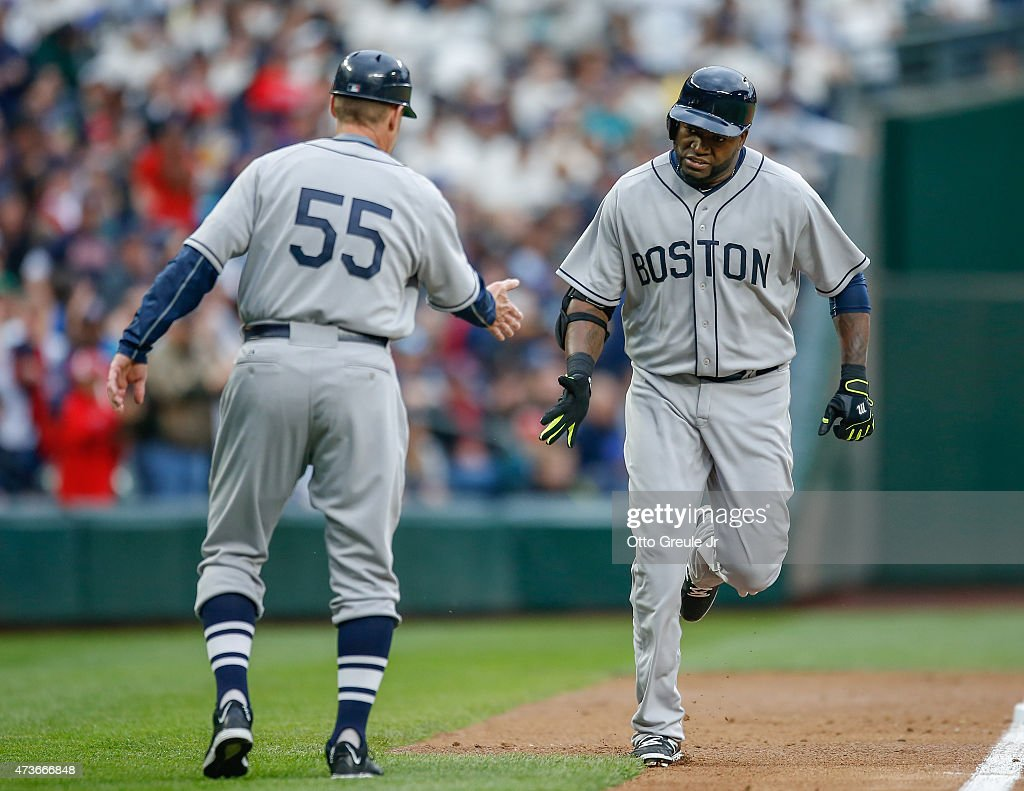 David Ortiz #34 of the Boston Red Sox is congratulated by third base coach Brian Butterfield #55 following a solo home run against the Seattle Mariners in the third inning at Safeco Field on May 16, 2015 in Seattle, Washington.