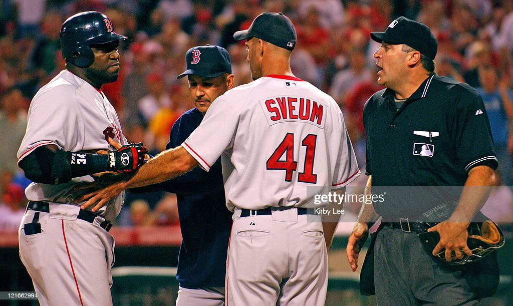 David Ortiz of the Boston Red Sox is restrained by manager Terry Francola and third-base coach Dale Sveum after being ejected by home plate umpire Bill Welke during 4-3 victory in 10 innings over the Los Angeles Angels of Anaheim at Angel Stadium in Anaheim, Calif. on Friday, August 19, 2005.