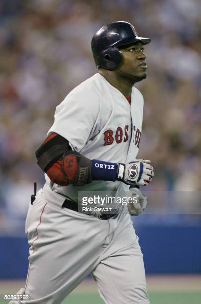David Ortiz of the Boston Red Sox jogs during the game against the Toronto Blue Jays on May 15 2004 at Skydome in Toronto Ontario Canada The Red Sox...
