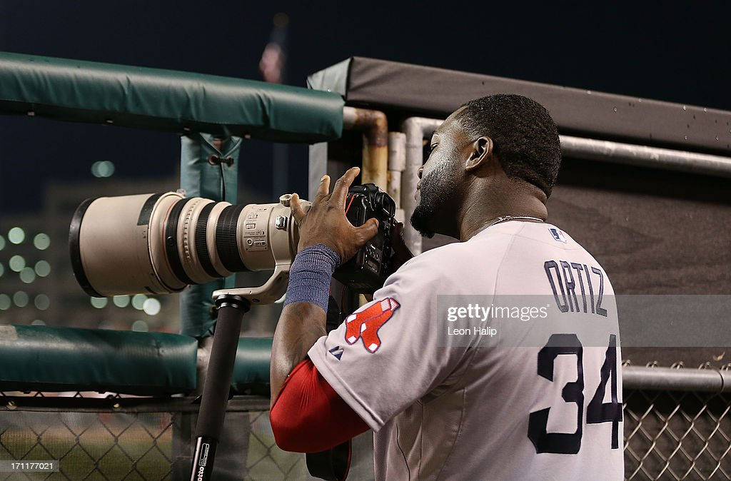 David Ortiz #34 of the Boston Red Sox picks up a camera during the eighth inning of the game against the Detroit Tigers at Comerica Park on June 22, 2013 in Detroit, Michigan. The Tigers defeated the Red Sox 10-3.