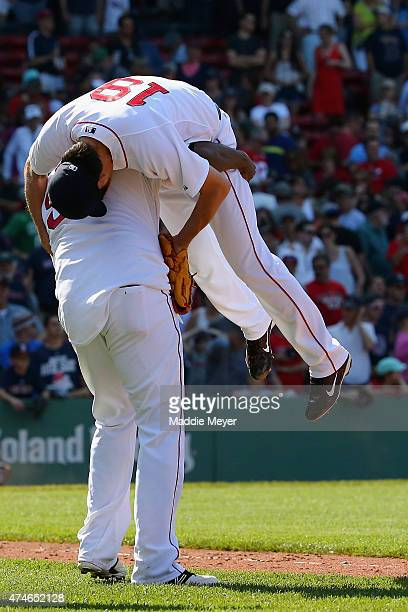 David Ortiz of the Boston Red Sox picks up Koji Uehara after the Red Sox 6-1 win over the Los Angeles Angels of Anaheim during the ninth inning at...