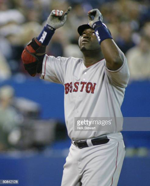 David Ortiz of the Boston Red Sox points skyward as he crosses homeplate after hitting a homerun in the 5th inning against the Toronto Bluejays on...