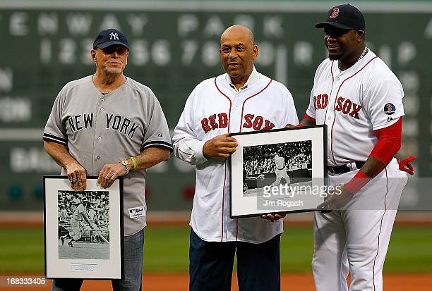 David Ortiz of the Boston Red Sox presents photographs to Ron Blomberg and Orlando Cepeda former designated hitters in Major League Baseball during a...