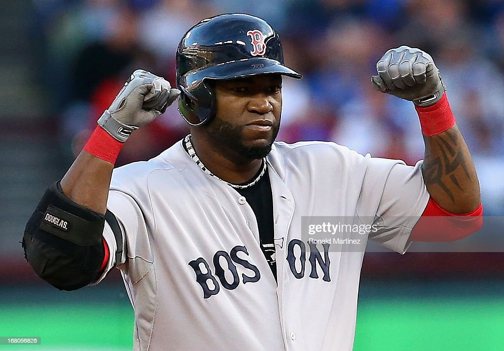David Ortiz #34 of the Boston Red Sox pumps his fist after hitting a double against the Texas Rangers at Rangers Ballpark in Arlington on May 4, 2013 in Arlington, Texas.