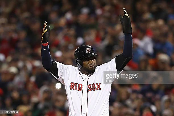 David Ortiz of the Boston Red Sox pumps up the crowd in the eighth inning against the Cleveland Indians during game three of the American League...