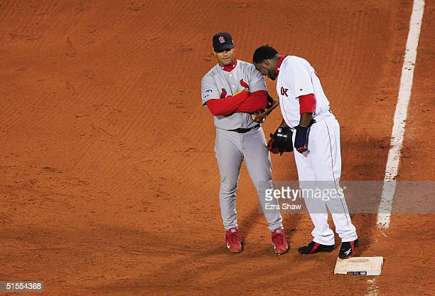 David Ortiz of the Boston Red Sox puts his head on the shoulder of Albert Pujols of the St Louis Cardinals after reaching first base safely on a RBI...