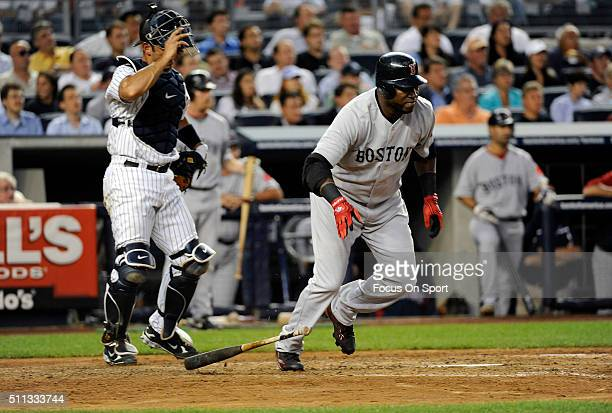 David Ortiz of the Boston Red Sox puts the ball in play and runs towards first base against the New York Yankees during an Major League Baseball game...