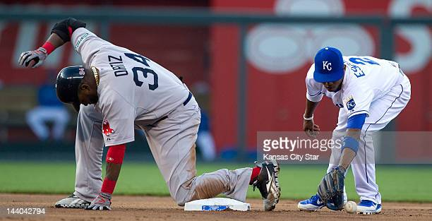 David Ortiz of the Boston Red Sox reaches second base before the throw reaches Kansas City Royals shortstop Alcides Escobar on a double in the first...