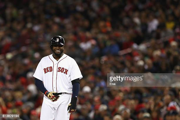 David Ortiz of the Boston Red Sox reacts after being walked in the second inning against the Cleveland Indians during game three of the American...