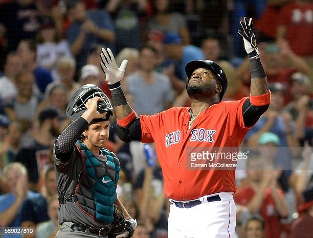 David Ortiz of the Boston Red Sox reacts after hitting a home run in the seventh inning as Tuffy Gosewisch of the Arizona Diamondbacks looks on at...
