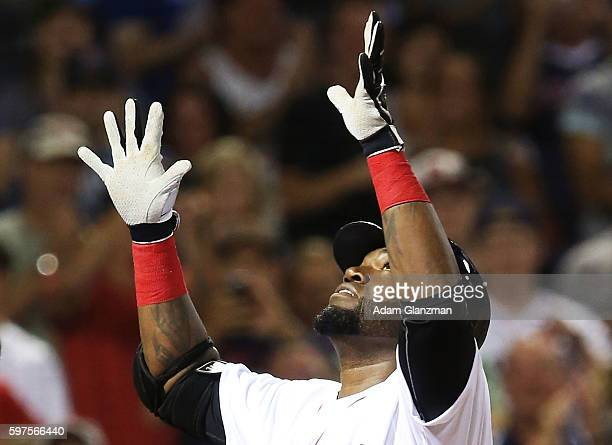 David Ortiz of the Boston Red Sox reacts after hitting a solo home run in the fourth inning during a game against the Kansas City Royals on August 28...