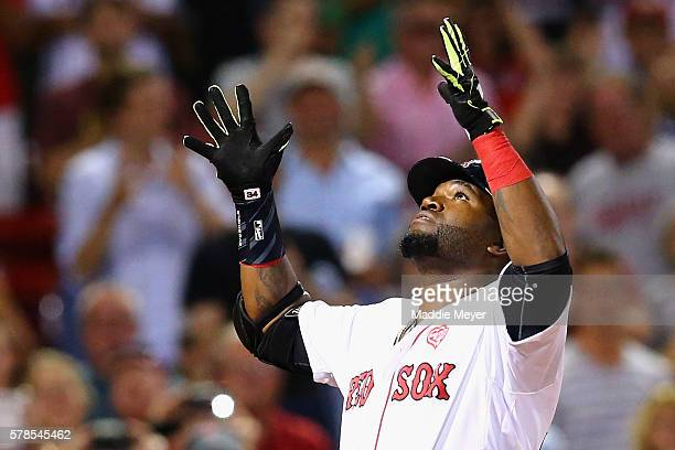 David Ortiz of the Boston Red Sox reacts after hitting a two run homer during the eighth inning against the Minnesota Twins at Fenway Park on July 21...