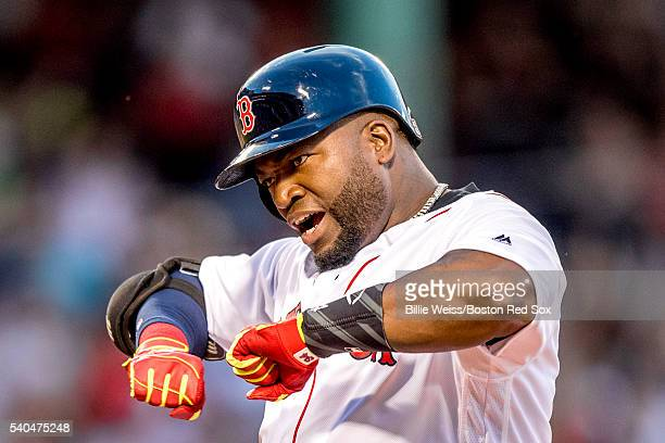 David Ortiz of the Boston Red Sox reacts after hitting an RBI single during the third inning of a game against the Baltimore Orioles on June 15 2016...