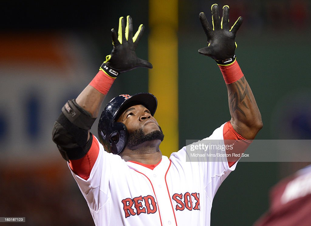 David Ortiz #34 of the Boston Red Sox reacts after hitting his second home run of the game against David Price #14 of the Tampa Bay Rays during the eighth inning of game two of the American League Division Series on October 5, 2013 at Fenway Park in Boston, Massachusetts.
