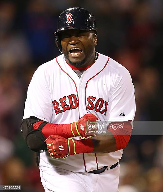 David Ortiz of the Boston Red Sox reacts after making the final out with the bases loaded in the ninth inning against the New York Yankees at Fenway...