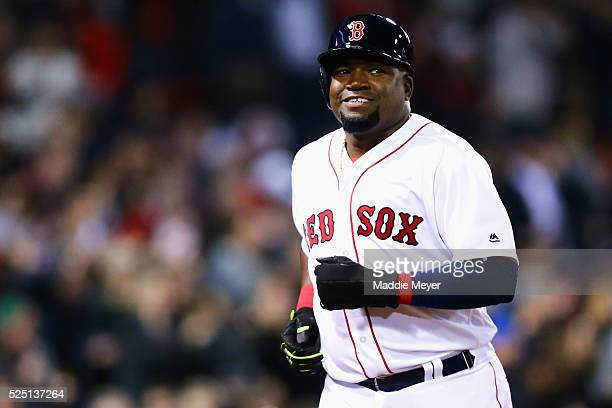 David Ortiz of the Boston Red Sox reacts after scoring a run against the Atlanta Braves during the fourth inning on April 27, 2016 in Boston,...