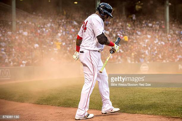 David Ortiz of the Boston Red Sox reacts as wind blows dust on the field during the first inning of a game against the Minnesota Twins on July 23...