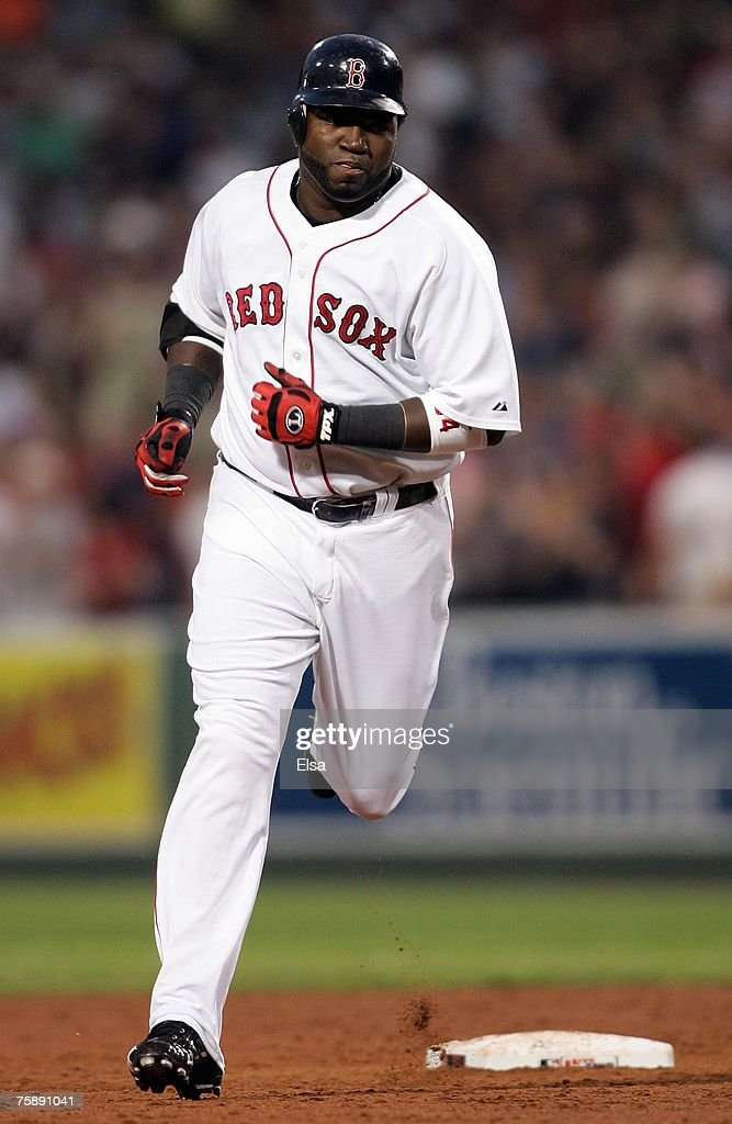 David Ortiz #34 of the Boston Red Sox rounds the bases after hitting a two run homer in the third inning against the Baltimore Orioles on July 31, 2007 at Fenway Park in Boston, Massachusetts.