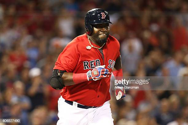 David Ortiz of the Boston Red Sox runs to first base during a game against the Kansas City Royals on August 26 2016 at Fenway Park in Boston...