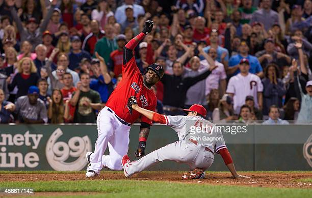 David Ortiz of the Boston Red Sox scores as he slides and avoids the tag of Jeanmar Gomez of the Philadelphia Phillies during the seventh inning...