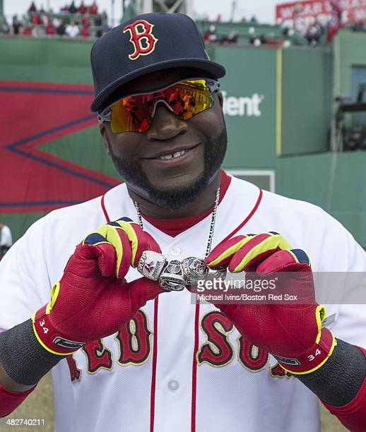 David Ortiz of the Boston Red Sox shows of his 2004 2007 and 2013 championship rings along with a ring honoring his 2013 World Series MVP selection...
