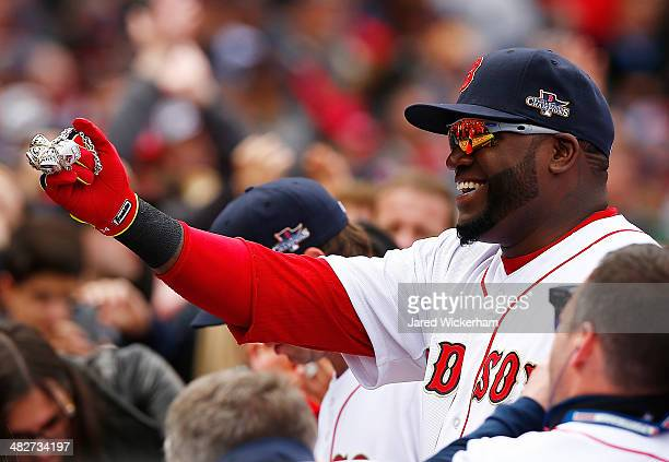 David Ortiz of the Boston Red Sox shows off his World Series rings prior to the Opening Day game between the Boston Red Sox and the Milwaukee Brewers...