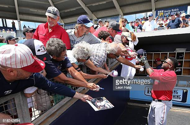 David Ortiz of the Boston Red Sox signs autographs for fans prior to the star of the Spring Training Game against the Tampa Bay Rays on March 30 2016...
