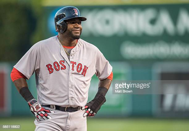 David Ortiz of the Boston Red Sox smiles while on base during the second inning of the game against the Los Angeles Angels of Anaheim at Angel...