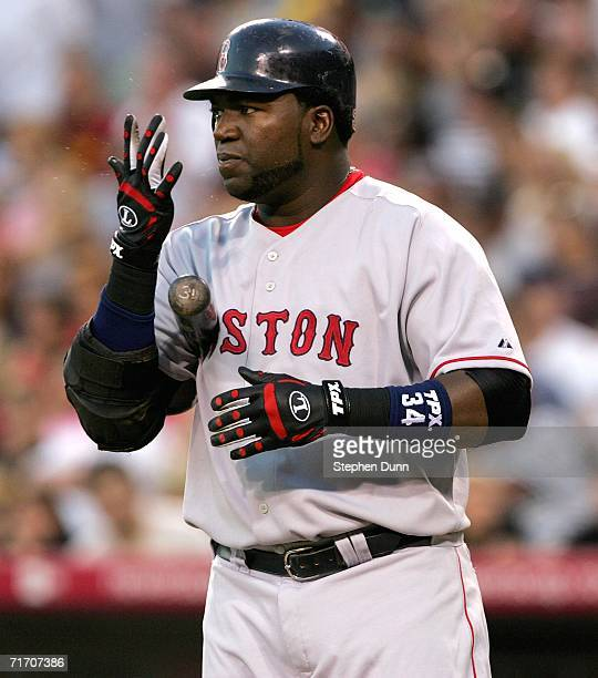 David Ortiz of the Boston Red Sox spits into his hand as he steps to the plate before hitting a two run home run in the first inning against the Los...