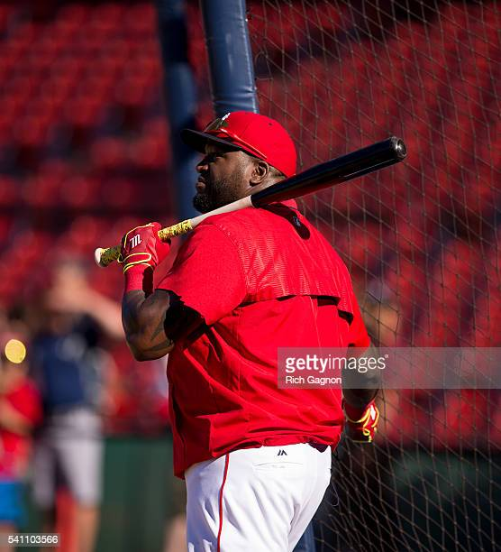 David Ortiz of the Boston Red Sox stands behind the batting cage before a game against the Seattle Mariners at Fenway Park on June 17 2016 in Boston...