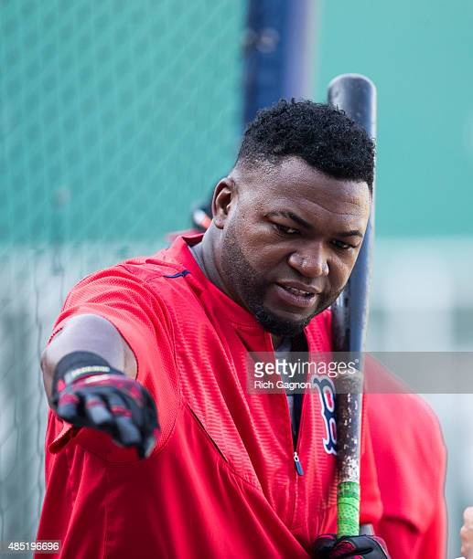 David Ortiz of the Boston Red Sox stands outside the batting cage before a game against the Kansas City Royals at Fenway Park on August 20 2015 in...